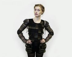 Couture Collection presentation: Juliana Sissons, at the V&A, 2011 | V&A Black cotton knitted dress with black copper wire and gold lurex lace panels; detachable sleeves and black cotton knitted shorts.