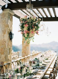 How stunning is this floral adorned chandelier?! http://www.stylemepretty.com/vault/gallery/38307   Photography: Erich McVey - http://www.erichmcvey.com/