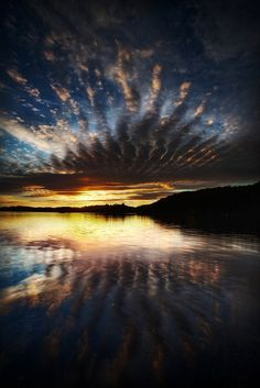 As the water reflects the sky, we become a reflection of this beautiful world by allowing it to inspire us.