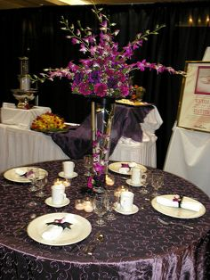 Centerpiece-purple orchids and carnations by Rose of Sharon Floral Designs, via Flickr