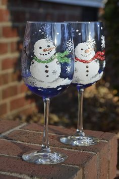 Whimsical Snowmen hand painted wine glass  https://www.facebook.com/pages/Cranial-BandsMurals-by-Leigh-Gibson/153150921414230
