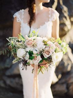 Huge oversized bouquet with muted colors but not any pink. Bridesmaids in flower crowns with lavender poseys for ceremony
