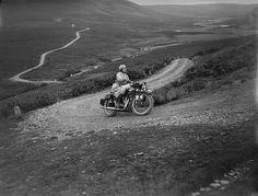 A woman rider in the Six Days Motorcycle Trial, in which competitors have to cover 200 miles a day over rough terrain, 1933