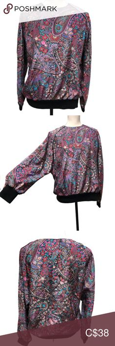 """Vintage Dolman Sleeve Paisley Parachute Blouse Vintage long-sleeve top in a vibrant, floral paisley pattern. Care tag is missing, but the fabric is smooth, shiny, and feels like a parachute. Loose fit, the fabric is not stretchy. This hot 90's top by Impromptu would look awesome with some high waisted mom jeans, or a pencil skirt. No size tag, but fits like a Medium. Would also look great as a baggy shirt on a size Small.   Measurements (approximate) Armpit to armpit: 23"""" Length (front… Baggy Shirts, High Waisted Mom Jeans, Plus Fashion, Fashion Tips, Fashion Trends, Blouse Vintage, Paisley Pattern, Loose Fit, Long Sleeve Tops"""