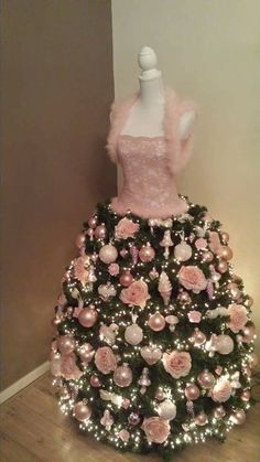 Pretty in pink Christmas tree couture. Mannequin Christmas Tree, Dress Form Christmas Tree, Pink Christmas Tree, Shabby Chic Christmas, Noel Christmas, Beautiful Christmas, Modern Christmas, Christmas Skirt, Disney Christmas