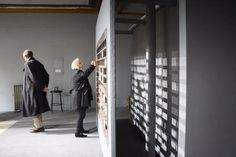 The Wall Speaks — BANK SUEY. Bricks with stories from war survivors on them are picked up by guests, who write their own experience or feeling on the other side and then place it in this wall
