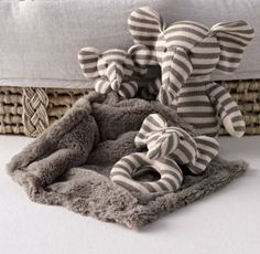 RH Baby & Child's Luxe Knit Security Blanket:Give someone new to the world the gift of comfort. Offering a soothing texture for tiny hands, our supremely soft security blanket is clutched in a cuddly critter's arms – complete with ears and an embroidered, loveable face.
