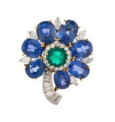 * A Fine 18 Karat Yellow Gold, Platinum, Sapphire, Emerald and Diamond Flower…