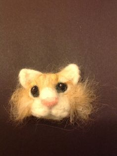 Felted cat brooch... Ginge, made with his own hair ( which felted well)