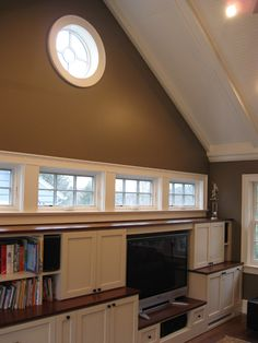 "rather than doing crown molding, dress up the vaulted ceiling with beadboard and ""beams"""