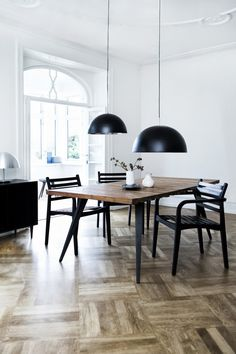 white walls, parquet floor, pendant lamps, dining table