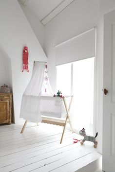 Simple nursery filled with natural light (via Nieuw huis met...