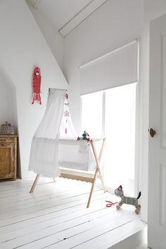 Simple nursery filled with natural light (via Nieuw huis met...