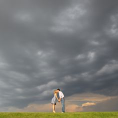 Cool sky, Engagement photo, Aaron Snow Photography, kissing couple, storm, oklahoma,