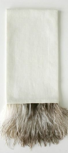 A salt and pepper plume gracefully trim our linen Ostrich Feather Guest Towels to bring an element of visual drama to the guest bath. Place by the sink basin or atop towel racks to add a dimension of tufted eloquence to decor.
