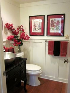 Updated powder room tutorial on the blog! The red and black color scheme ties everything together with the towels, wall art, re-purposed vanity and fresh picked red flowers.