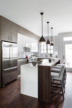 Written by Julie Sanders, this renovation included a kitchen design by Sarah Kahn Turner of Jennifer Gilmer Kitchen & Bath, Ltd. that features a Grothouse Wenge Raised Pastore Counter for the kitchen island.  #GrothouseThings #WengeRaised #PastoreCounter #WoodInnovation