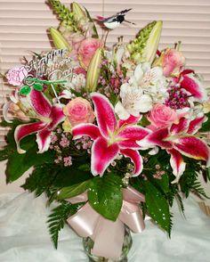 Fantasy Flowers & More ~ Stargazer Lilies, Pink Roses, White Alstroemeria, Pink Snapdragon, & Wax flower. www.fantasyflowersandmore.com