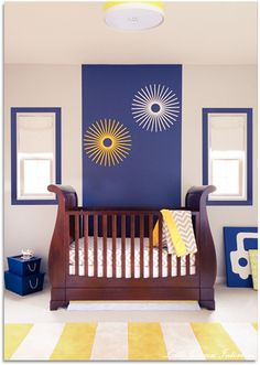 Yellow and blue color combination give this nursery a modern and contemporary look. #baby #nursery #littlecrowninteriors