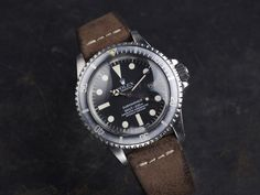 1978 Rolex Sub, Ref. 1680 on a B&B strap. (Click on photo for high-res. image.) Photo found here: https://bulangandsons.com/portfolio_page/curated-ghost-rebel-rolex-1680-submariner/