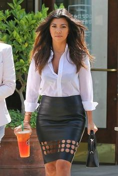 White blouse tucked into black (leather?) skirt with cutouts- Courtney Kardashian