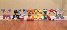 Paw Patrol letter art. Hand painted wood letters. Kids room/nursery decor. Home decor. Wall letters. Price listed is per letter!