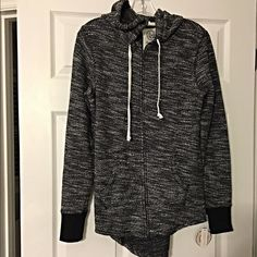 NWT black an white marled hi lo hoodie-cute! Adorable- zip up- tie top- kangaroo pocket in marled black and white with cozy hoodie! Chic and comfy Sweaters