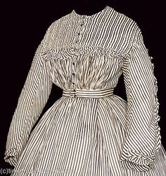 S290-2 by pseitas, via Flickr. [Probably c. 1865: the skirt has a large, flat box pleat in front.]
