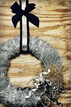 DIY Tinsel New Years Wreath  Affordable, quick, and easy to make! White letter F silver paint pen all over sahing happy new year