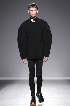 John Galliano Menswear Fall Winter 2014 Paris. Proportions are off-oversized sweater and uber-skinny legs.