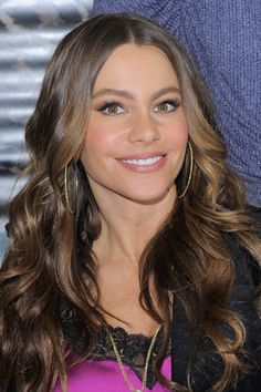 A soft, neutral brown not only looks great on a variety of skin tones, but it can be a low-maintenance color - like Sofia Vergara's light brown shade. Find your complementary color here: www.esalon.com #cover #gray #hair