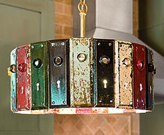 """Pinning this not only for the project (I HAVE some of these door-thingies!), but even more for the """"hey..."""" quote. Love it!    Antique chippy paint doorsets -- transformed into a pendant chandelier. Genius! Patina is good. Hey: I don't have """"wrinkles"""" -- I have """"patina"""". The light is from Napa Style."""