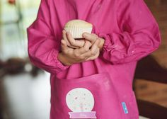 A Stuck on You Art Smock in pink with a Spring Nest design www.stuckonyou.biz