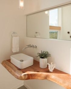We dig this Douglas fir countertop in a Seattle bathroom by @jwarchitects. Read more on dwell.com. Photo by @laraswimmer.