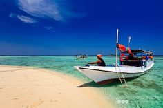 Tourist boats in the crystal clear waters around the small island of Pulau Geleang, located within the Marine National Park of Karimunjawa or Karimun Jawa, which translates as a stone's throw from Java. Marine National Park, National Parks, Karimun Java, Crystal Clear Water, North Coast, Small Island, Travel Photographer, Coastal Living, Bali