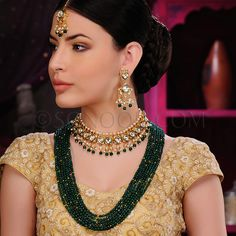 BRI/1/3403 Aradhya Bridal Set with includes Necklace, Rani Haar, Maang Tika, and Earrings dull gold finish studded with kundan and green quartz stones 	 $598	 £353