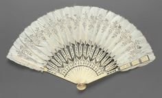Woman's white feather wedding fan, about 1835.