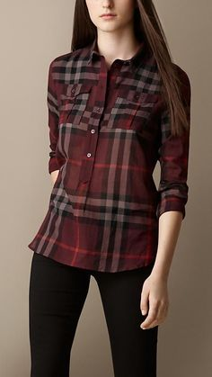 Burberry - Check Cotton Smock Shirt: This contemporary fitting shirt has a half placket (only buttons half-way down), making it easy to tuck in – no little open spaces by the waist of your pants or skirt.