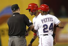 CrowdCam Hot Shot: Texas Rangers right fielder Alex Rios is held by by third base coach Gary Pettis as he argues with third base umpire Andy Fletcher after being called out at third base in the eighth inning of the game against the Oakland Athletics at Rangers Ballpark in Arlington. The Oakland Athletics beat the Texas Rangers 9-8. Photo by Tim Heitman