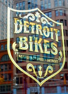 A gold window sign by Golden Sign Co. for Detroit Bikes incorporated and gold leaf. Photo by Michelle Gerard Detroit Art, Detroit History, Detroit Michigan, Typography Letters, Hand Lettering, Chalk Typography, Window Signage, Window Graphics, Signwriting