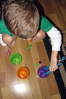 Sorting blocks by colors w/ tongs. Fabulous sensory and small motor idea for kids ages 2-4