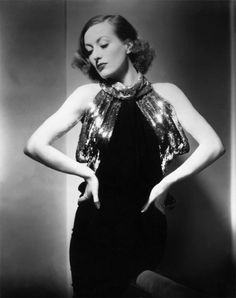 Joan Crawford. Fashions for movies in the 40s were so so elegant.