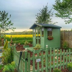 This She Shed even has a matching picket fence. So cute!