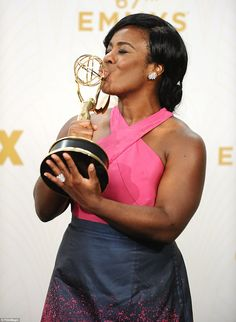 Proud moment: The two-time Emmy winner kissed her latest trophy backstage after the show...