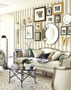 Tone down a striped wall with a gallery of various types of art.