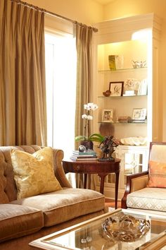 Custom silk pinch pleat drapes add a touch of elegance to this room.