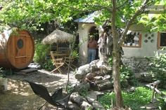 cob stone cottage   Little cob cottage, pond, and sauna