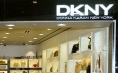 DKNY: ASL oversaw the design and construction of DKNY's Atlanta boutique. The granite portal juxtaposed with the crisp white interior helped create a visual draw from the surrounding concourse. A series of built in display boxes feature the various product lines.