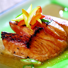 INGREDIENTS  2 salmon fillets    Marinade  2 T peanut oil  2 T soy sauce  2 T honey  1 T ginger, minced  1 c pineapple juice  1 T lime juice    Garnish  1 T scallions,  thinly sliced    DIRECTIONS: Marinade – Mix ingredients. Marinate salmon for 5-10 minutes. Sear salmon for 3 minutes per side. Garnish with scallions.