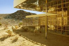 Just footsteps from Joshua Tree National Park are Acido Dorado and Rosa Muerta, two vacation rental homes built by architect Robert Stone. 78% of the gold-dipped Acido Dorado can be opened entirely to the outdoors, bringing the desert indoors. With sliding doors and mirrored walls and ceilings throughout, it's appearance changes as day progresses to evening.